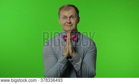 Handsome Man Hands In Prayer And Begging, Asking Permission Heartily, Looking At Camera With Implori