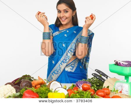 Woman With Vegetables In Her Kitchen