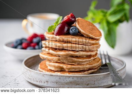 Vegan Gluten Free Buckwheat Pancakes With Berries On A Plate. Healthy Pancakes