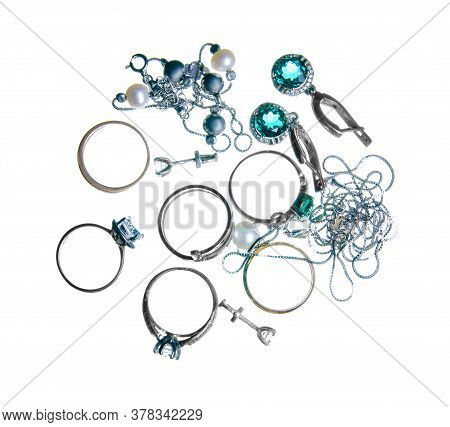 Rings, Earrings, Jewelry On White Background Isolation, Top View