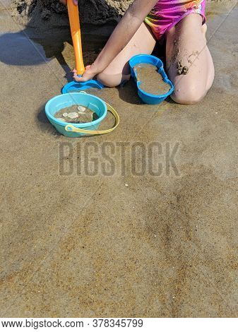 Close Up On Kids Playing Sand On The Beach