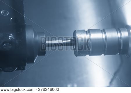 The Cnc Lathe Machine Bore Cutting The Metal Pulley Parts . The Hi-technology Metal Working Processi