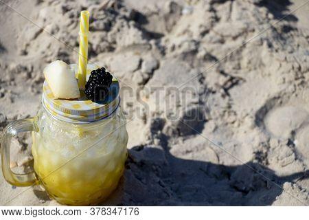 Melon Smoothie With Melon Chunks And Blackberries. By The Sea, Summer Vacation.
