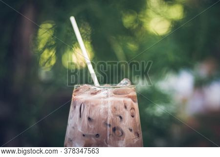 Close Up Summer Refreshment Drinks. Chilled Iced Chocolate Cocoa. Chocolate Powder And Ice. In Glass
