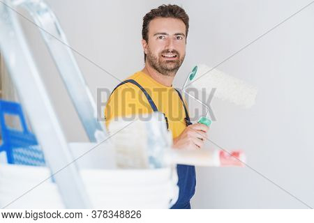 Painter Working At Home With Painting Tools
