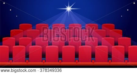 Rows Of Red Seats In The Empty Cinema Hall In The Dark. Bright Spotlight In The Background. Vector I