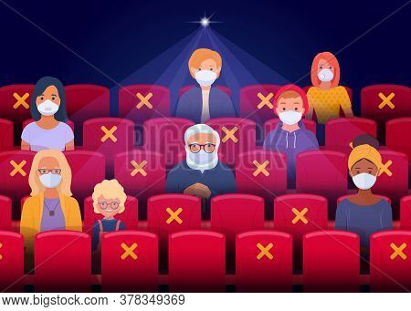 Social Distancing In The Cinema After The Quarantine Period. Spectators Wearing Face Masks Sit As Th