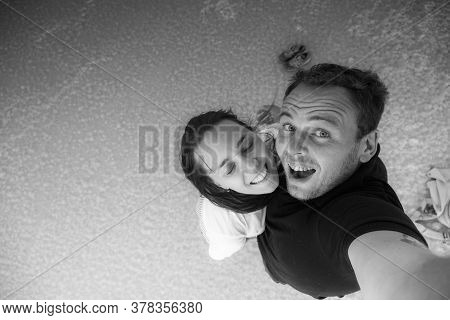 Black And White Photo Of A Happy Couple In Love. Selfie Photo Of Husband And Wife. Happy Tourists. T