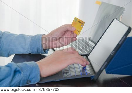 Man Typing Credit Card Number For Paying With Credit Card On Tablet At Home Office Shopping, Banking