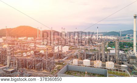 Aerial View Oil Refinery.industrial View At Oil Refinery Plant Form Industry Zone With Sunrise And C