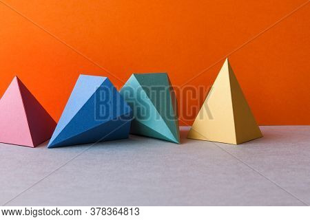 Colorful Geometric Abstract Still Life Composition. Bright Prism Pyramid Triangle Shape Figures. Vio