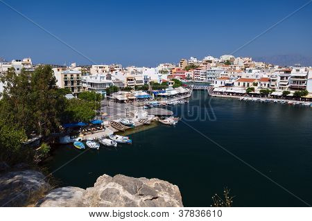 Panorama of Agios Nikolaos (or Ayios Aghios) town in Crete Greece. Showing famous places: Lake Marina Bay Old town. poster