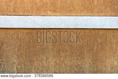 Grunge background with decorative stucco wall texture of brown color with border of white color. Horizontal or vertical banner with texture of stucco. Copy space for text