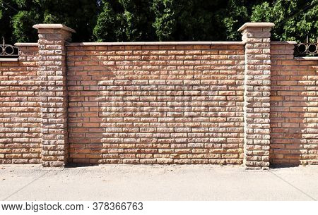 Fence of bricks. Wall with brick imitation decorative tiles. Copy space for text