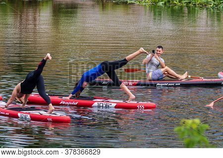 Kyiv Ukraine, The Dnieper River July 26, 2020: A Group Of Young Girls In The Middle Of The River Per