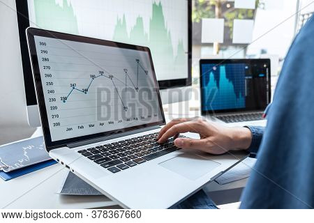 Businessman Investor Working In Traders Marketing And Planning And Analyzing Pointing On The Stock C