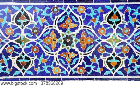 Detail of traditional persian mosaic wall with floral ornament of Masjid-e Jameh Mosque (Jame mosque,  Friday Mosque), Isfahan, Iran. UNESCO World Heritage Site