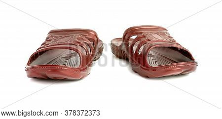 Pair Of Cheap Durable Orange Rubber Slippers Isolated On White Background.