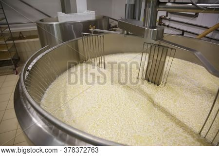Adding Water To Curd And Whey In Tank At Cheese Factory