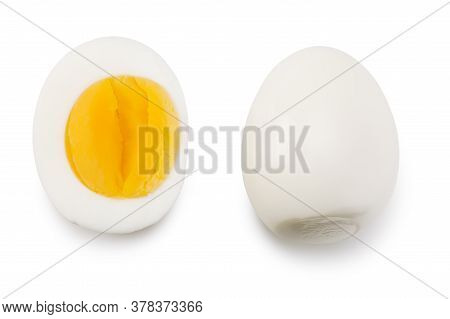 Single Whole Boiled Egg With Halved Egg Isolated On A White Background. Top View