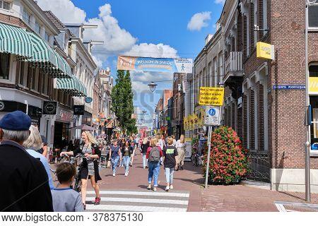 Sneek, Netherlands, June 20, 2020:busy Shopping Street With Dutch Social Distancing Coronavirus Guid