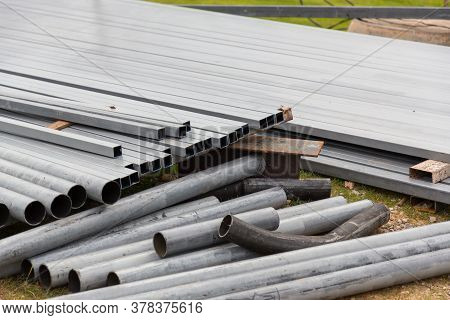 Steel Long Pipe For Industrial. Steel Pipes For Construction On Cement Floors. Group Of Steel Pipe F