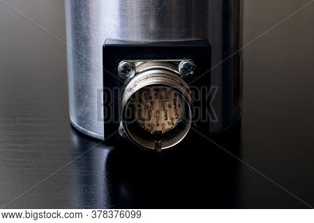 Metal Encoder On A Black Wooden Table