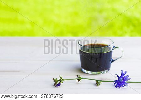 Hot Natural Chicory Caffeine Free Drink In A Transparent Cup On A Wooden Table Outdoors. Healthy Alt