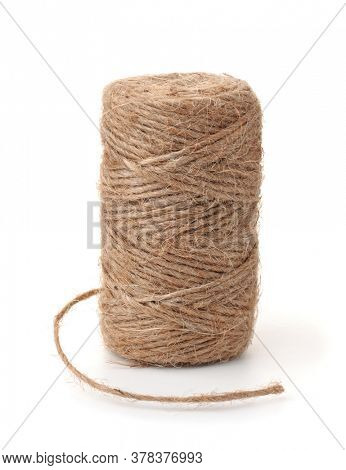 Skein of natural jute twine isolated on white