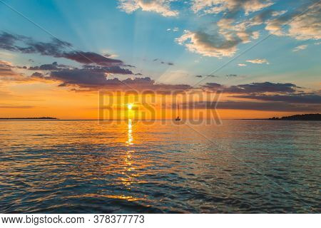 View Of Sail Boat On Sunset In Bay. Summer Vacation
