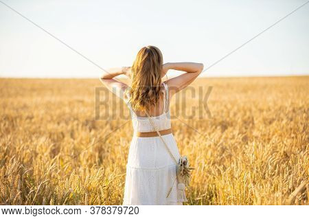 Happy Young Woman On Field In Summer Day In Czech Republic