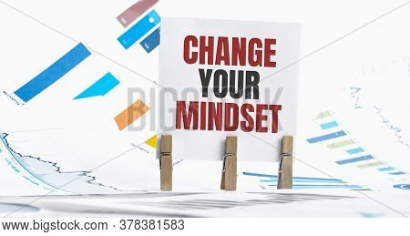 Change Your Mindset Text On Paper Sheet With Chart, Dice, Spectacles, Pen, Laptop And Blue And Yello