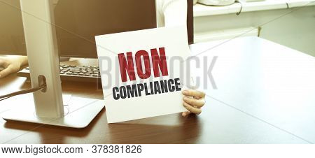 Businesswoman Holding A Card With Text Non Compliance