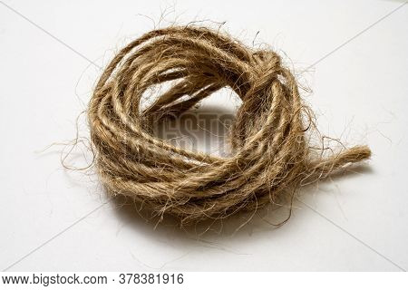 Jute Twine Isolated On White Background. Hank Of Twine Close-up. Jute Rope For Packing And Decoratio