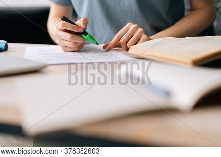 Close-up Of Hands Of Unrecognizable Businesswoman Highlighting Important Things In Paper Document Wi