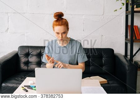 Professional Redhead Young Businesswoman Is Talking On Video Call At Home Office. Successful Busines