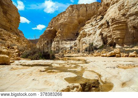 Beginning of a route. The concept of photo tourism. The magnificent gorge Ein Avdat is the most beautiful in the Negev desert. Within the walls there are many caves and rocks. Israel