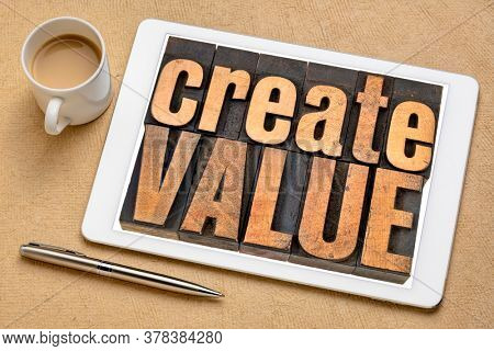 create value typography - words in vintage letterpress wood type blocks on a digital tablet, inspiration, creativity and business concept