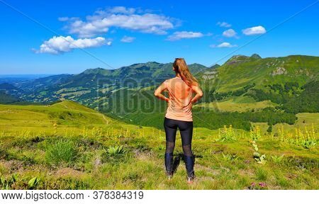 woman looking at the view, Cantal in France