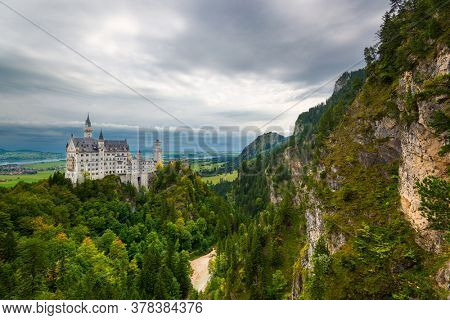 Neuschwanstein Castle with fog in the Bavarian Alps of Germany