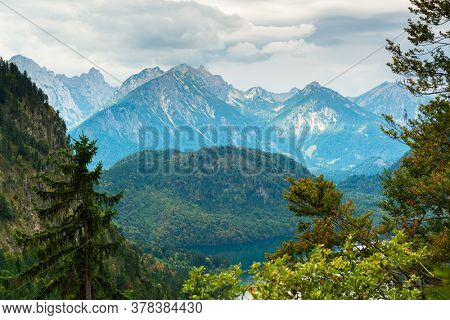 Bavarian Alps landscape in Fussen, Germany with Lake Alpsee.