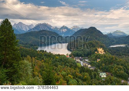 Bavarian Alps of Germany at Hohenschwangau Village and Lake Alpsee in the afternoon.