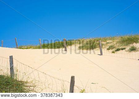 Beach View Dunes. Background Summer Sky. Natural Background. Scenic Travel Background. Blue Backgrou