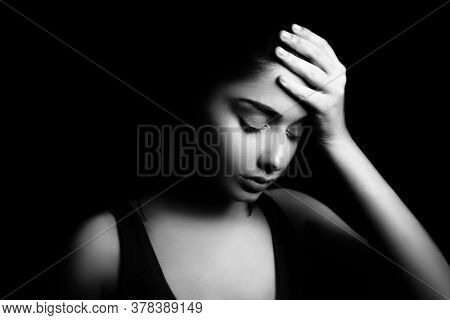 Headache health problem on young tired woman. Exhausted depressed female suffering from migraine or forehead fever