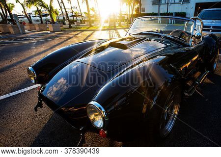Miami, Florida, Usa - June 2020: Luxurious Car In The Rays Of The Setting Sun Sunset. Super Car. Bea