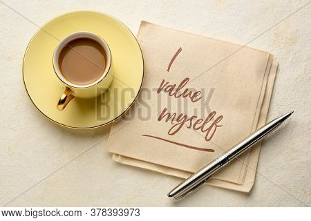 I value myself - handwriting on a npkin with a cup of coffee, positive affirmation, self respect and personal development concept