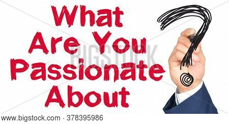 Hand With Marker Writing: What Are You Passionate About. Hand Of A Businessman With A Marker.
