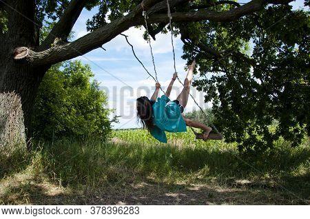 Gymnast Woman Fly On Swing Outdoor. Happy Woman Sport Lifestyle. Fitness Girl On Swing. Girl Swingin