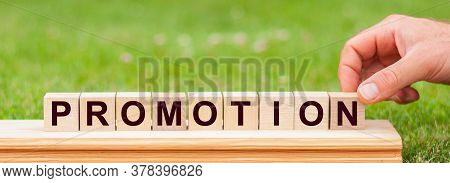 Promotion - Word From Wooden Blocks With Letters, Promotion Code, Top View On White Background