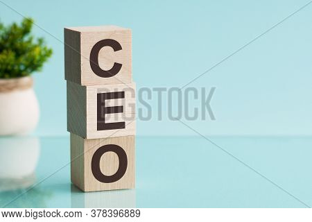 Ceo Word Made Of Wooden Cubes On A Blue Background With Copy Space, Business Concept